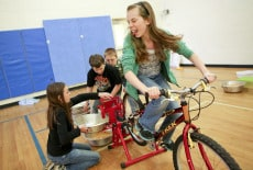 Students at Indian Valley Elementary School use a bike to grind locally grown corn.  Photo by Kyle Green   The Roanoke Times