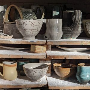 Kiln shelves in use by Elizabeth McAdams, studio assistant to Silvie Granatelli